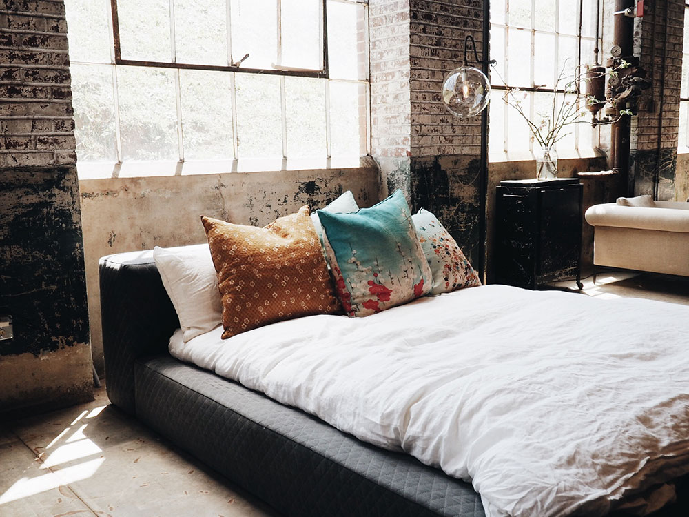 Image of a bed in a loft style apartment