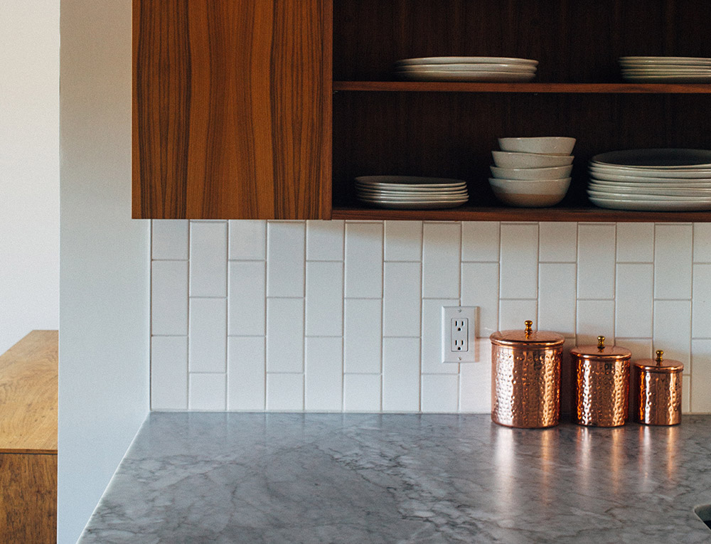 Image of three copper jars on a granite worksurface
