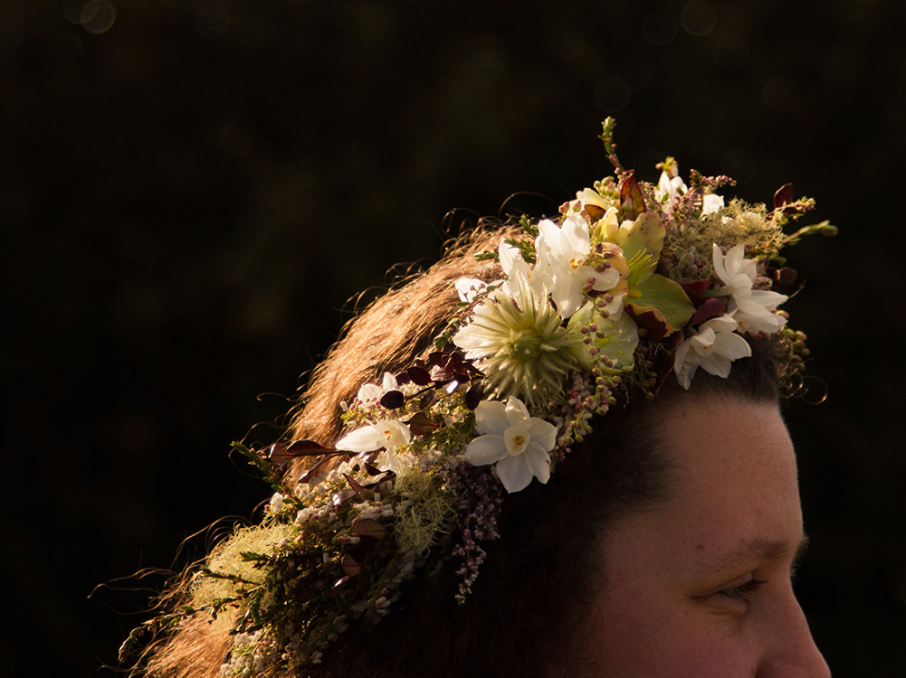 Image of a person wearing a floral crown