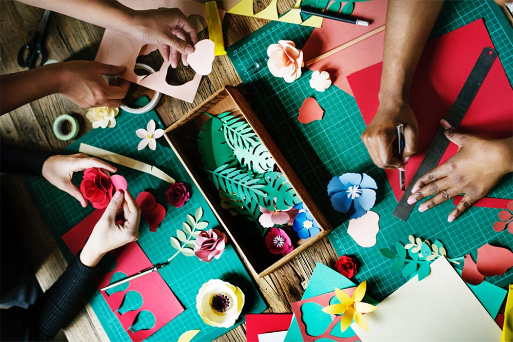 Image of hands crafting with paper