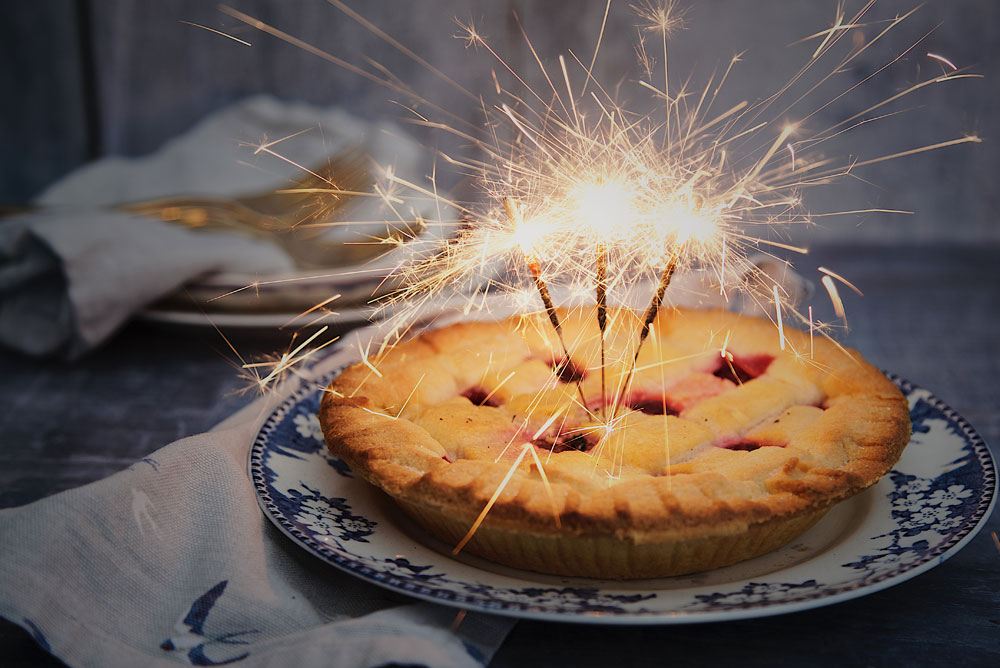 Image of apple pie with sparklers in the top