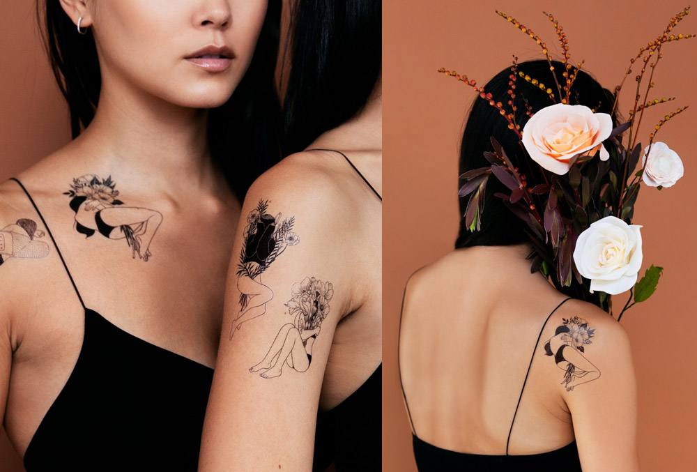 Image of two women wearing black line work Tattly tattoos surrounded by flowers